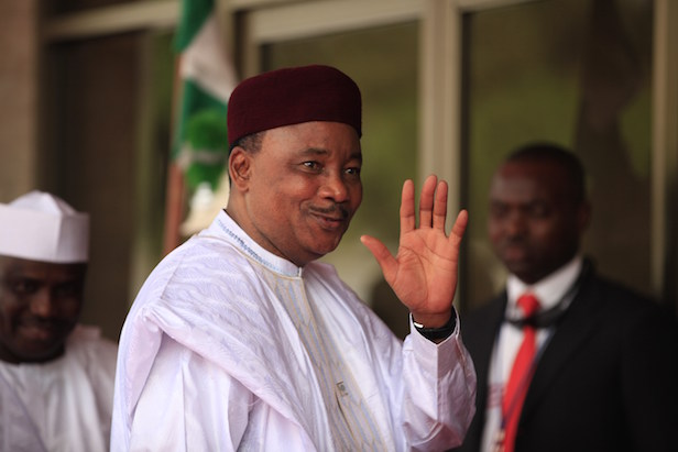 Niger's President Mahamadou Issoufou arrives for a summit to address a seminar on security during an event marking the centenary of the unification of Nigeria's north and south in Abuja, Nigeria, Thursday, Feb. 27, 2014, . (AP Photo/Sunday Alamba)